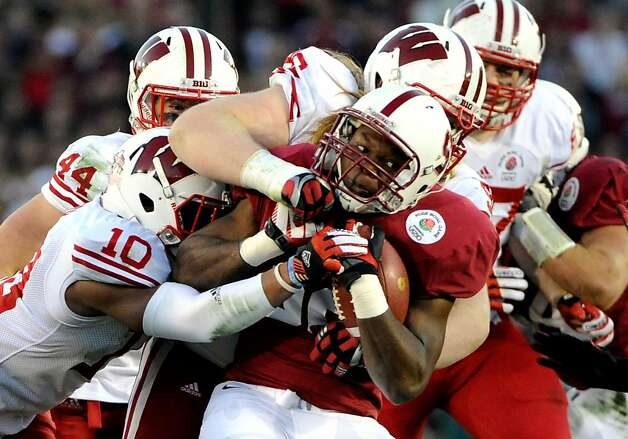 Stepfan Taylor #33 of the Stanford Cardinal is tackled for a five-yard loss in the second half against the Wisconsin Badgers in the 99th Rose Bowl Game Presented by Vizio on January 1, 2013 at the Rose Bowl in Pasadena, California. Photo: Robert Laberge, Getty Images