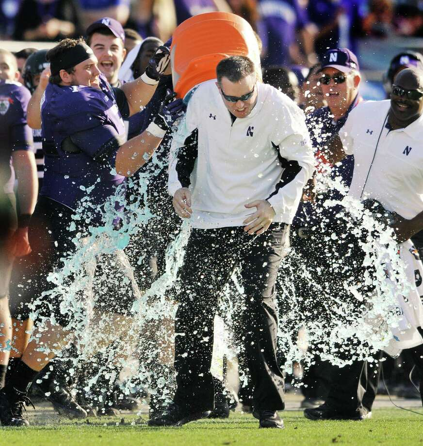 Northwestern coach Pat Fitzgerald is doused in the closing minute of the Wildcats 34-20 victory over Mississippi State in the Gator Bowl NCAA college football game, Tuesday, Jan. 1, 2013, in Jacksonville, Fla.   (AP Photo/The Florida Times-Union, Bob Self) Photo: Bob Self
