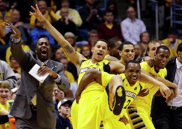 Marquette's bench reacts against Connecticut during the second half of an NCAA college basketball game, Tuesday, Jan. 1, 2013, in Milwaukee. (AP Photo/Jeffrey Phelps) Photo: JEFFREY PHELPS, Associated Press / FR59249 AP