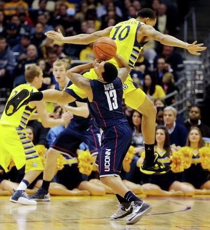 Marquette's Juan Anderson (10) defends against Connecticut's Shabazz Napier (13) during the first half of an NCAA college basketball game, Tuesday, Jan. 1, 2013, in Milwaukee. (AP Photo/Jeffrey Phelps) Photo: JEFFREY PHELPS, Associated Press / FR59249 AP