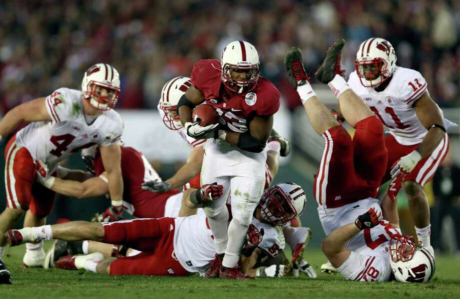 PASADENA, CA - JANUARY 01:  Running back Stepfan Taylor #33 of the Stanford Cardinal runs the ball in the fourth quarter against Ethan Hemer #87 of the Wisconsin Badgers in the 99th Rose Bowl Game Presented by Vizio on January 1, 2013 at the Rose Bowl in Pasadena, California.  (Photo by Jeff Gross/Getty Images) Photo: Jeff Gross