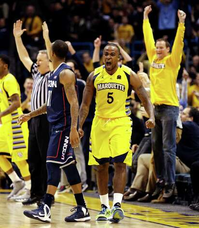 Marquette's Junior Cadougan (5) reacts to his 3-pointer that tied the score at the end of regulation against Connecticut in their NCAA college basketball game, Tuesday, Jan. 1, 2013, in Milwaukee. Marquette won 82-76 in overtime. (AP Photo/Jeffrey Phelps) Photo: JEFFREY PHELPS, Associated Press / FR59249 AP