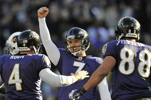 Baltimore Ravens kicker Billy Cundiff (7) celebrates his game-winning field goal with teammates Sam Koch (4) and Dennis Pitta (88) during the second half of an NFL football game against the Arizona Cardinals in Baltimore on Sunday, Oct. 30, 2011. The Ravens defeated the Cardinals 30-27. (AP Photo/Gail Burton) Photo: Gail Burton, Associated Press