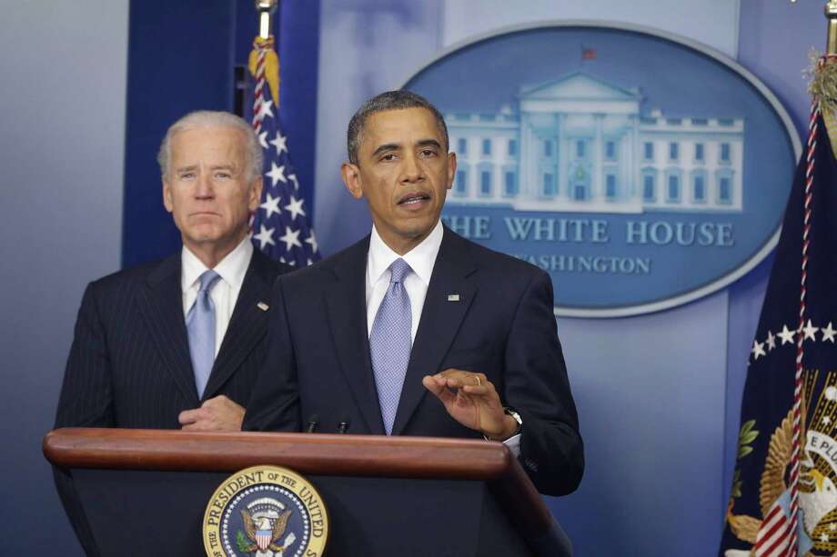 President Barack Obama and Vice President Joe Biden makes a statement regarding the passage of the fiscal cliff bill in the Brady Press Briefing Room at the White House in Washington, Tuesday, Jan. 1, 2013. (AP Photo/Charles Dharapak) Photo: Charles Dharapak, Associated Press / AP