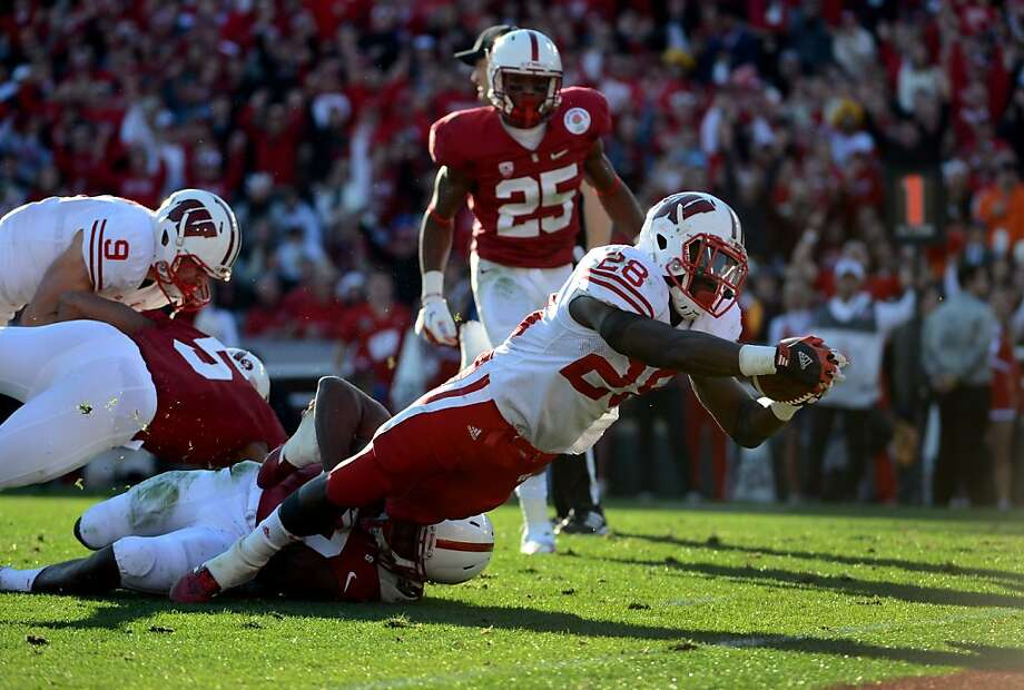 Montee Ball dives to score a TD for Wisconsin, which was thwarted earlier at the goal line. Photo: Harry How, Getty Images