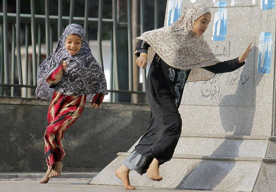 The New Year's day holiday brings Egyptian children out to play on the street in the affluent neighborhood of Zamalek, Cairo, Egypt, Tuesday, Jan. 1, 2013. (AP Photo/Amr Nabil) Photo: Amr Nabil, Associated Press