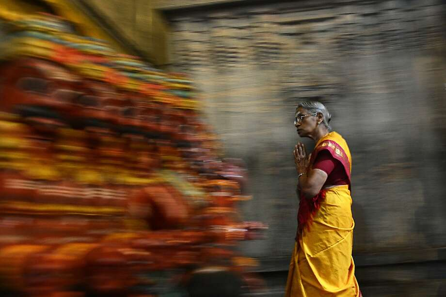 In an age-old new year's ritual,a Hindu offers prayers at a temple in Colombo, Sri Lanka. Photo: Ishara S.Kodikara, AFP/Getty Images