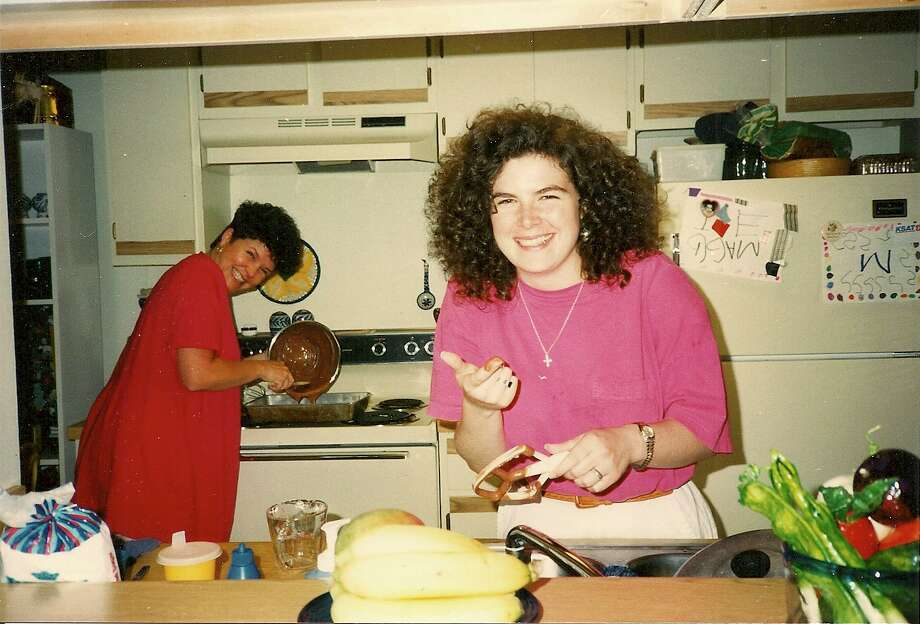 Then: In this photo from 1989, sisters Stephanie, 27 at the time, and Amy, 21, bake the family s traditional chocolate birthday cake using a recipe passed down from the grandmother. Photo: Courtesy Photo