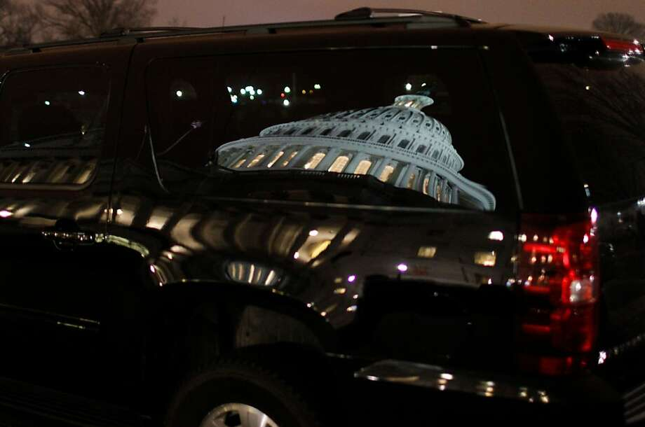 "The US Capitol is reflected in a Suburban automobile on the Capitol Plaza January 1, 2013 in Washington, DC. After fervent New Year brinkmanship, the US Congress late January 1st  finally backed a deal to avert a ""fiscal cliff"" of tax hikes and slashing spending cuts that had threatened to unleash economic calamity. Photo: Molly Riley, AFP/Getty Images"