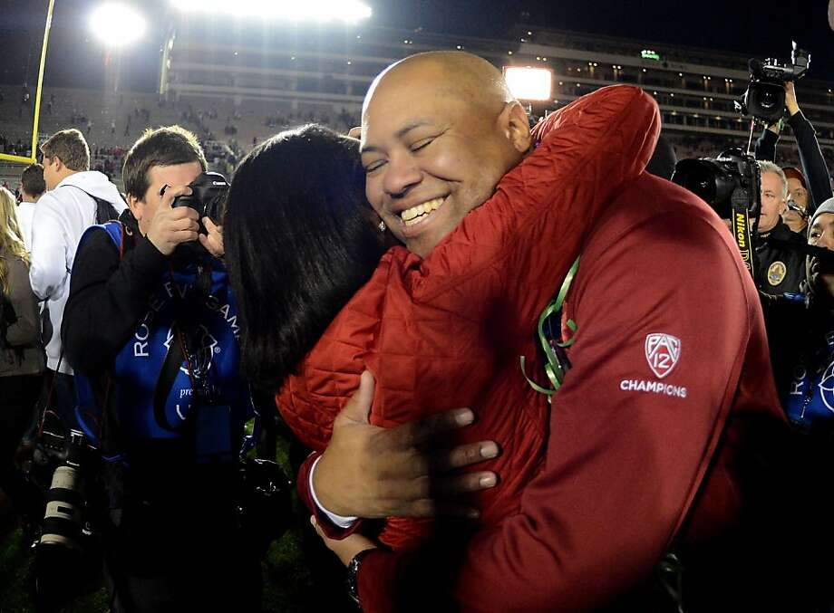 PASADENA, CA - JANUARY 01:  Head coach David Shaw of the Stanford Cardinal celebrates with former Secretary of State and Cardinal alum Condoleezza Rice after the Cardinal defeat the Wisconsin Badgers 20-14 in the 99th Rose Bowl Game Presented by Vizio on January 1, 2013 at the Rose Bowl in Pasadena, California.  (Photo by Harry How/Getty Images) Photo: Harry How, Getty Images