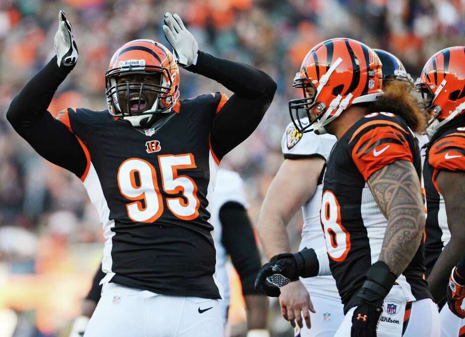 The Bengals' season sack total is just one off the NFL's best for 2012, and Wallace Gilberry (61/2), left, is part of a defensive line that has dominated during Cincinnati's 7-1 record over the second half of the season. Photo: Michael Keating, FRE / FR170759 AP