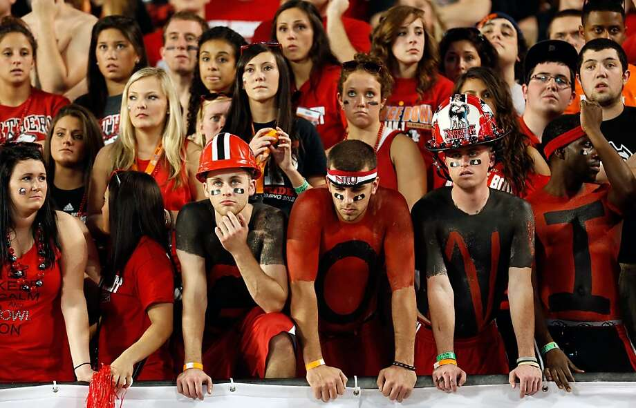 MIAMI GARDENS, FL - JANUARY 01:  Fans of the Northern Illinois Huskies look on dejected in the stands against the Florida State Seminoles during the Discover Orange Bowl at Sun Life Stadium on January 1, 2013 in Miami Gardens, Florida.  (Photo by Chris Trotman/Getty Images) Photo: Chris Trotman, Getty Images