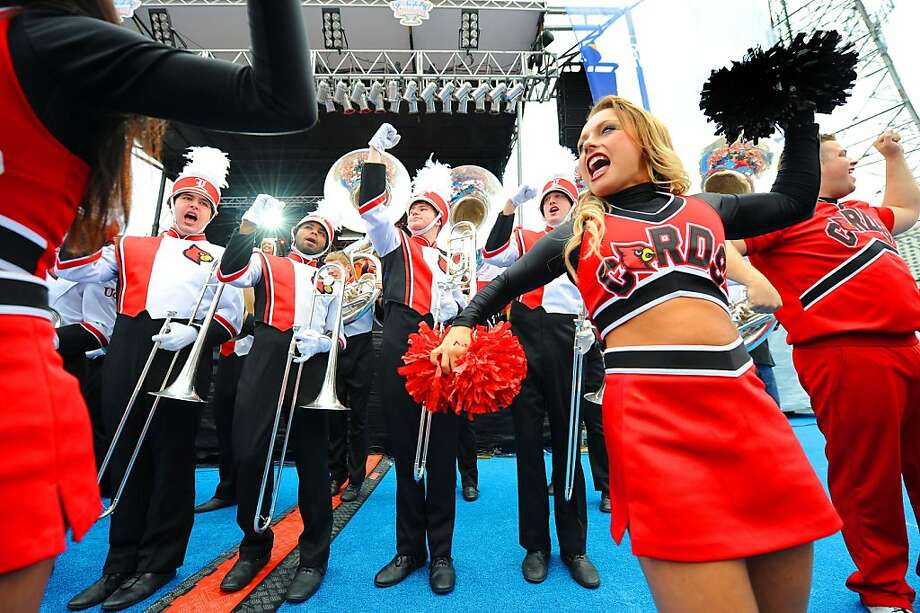 IMAGE DISTRIBUTED FOR ALLSTATE- University of Louisville marching band and cheerleaders excite Cardinals fans football fans at the school's pep rally at the Allstate Fan Fest in New Orleans, La., on Jan. 1, 2012. Louisville plays the Florida Gators in the 79th Sugar Bowl at the Mercedes-Benz Superdome on Jan. 2, 2012. (Cheryl Gerber/AP Images for Allstate)
