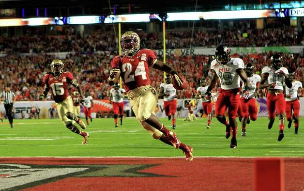 Discover Orange Bowl, Jan. 1: Florida State 31, Northern Illinois 10; Sun Life Stadium in Miami; Payout: $17,000,000 PHOTO: Florida State's Lonnie Pryor (24) scores a 60-yard rushing touchdown in the first quarter against Northern Illinois during the Orange Bowl. Photo: Chris Trotman, Getty Images / 2013 Getty Images