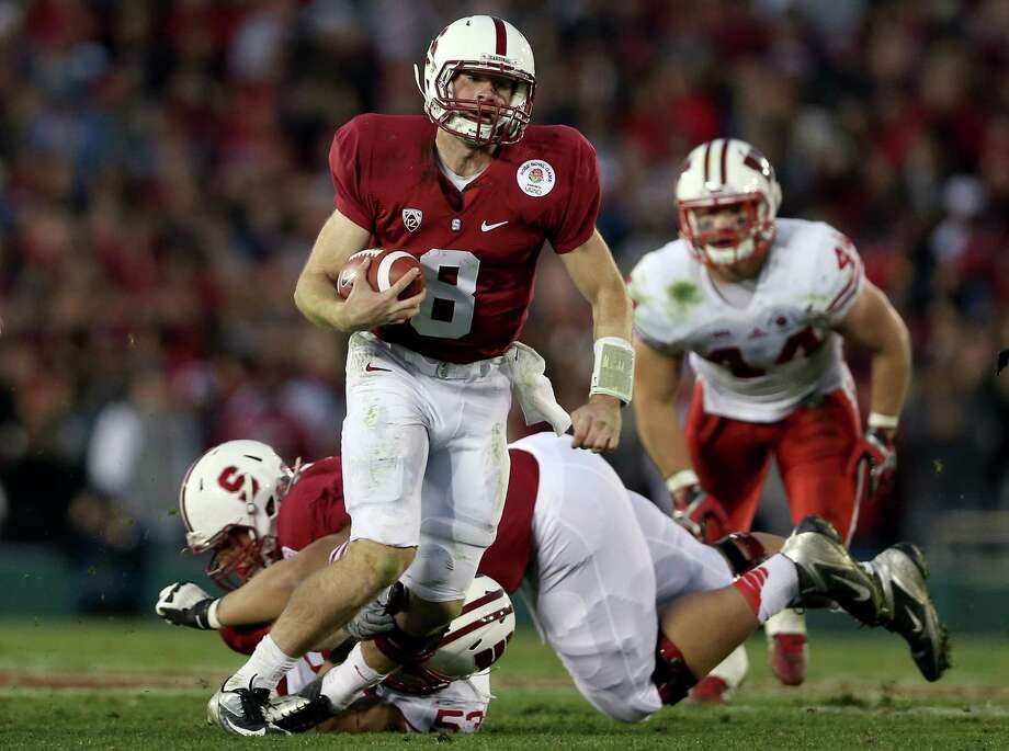 Rose Bowl Game presented by Vizio, Jan. 1: Stanford 20, Wisconsin 14; Rose Bowl in Pasadena, Calif.; Payout: $17,000,000 PHOTO: Stanford quarterback Kevin Hogan (8) runs the ball in the fourth quarter against the Wisconsin Badgers in the 99th Rose Bowl. Photo: Jeff Gross, Getty Images / 2013 Getty Images