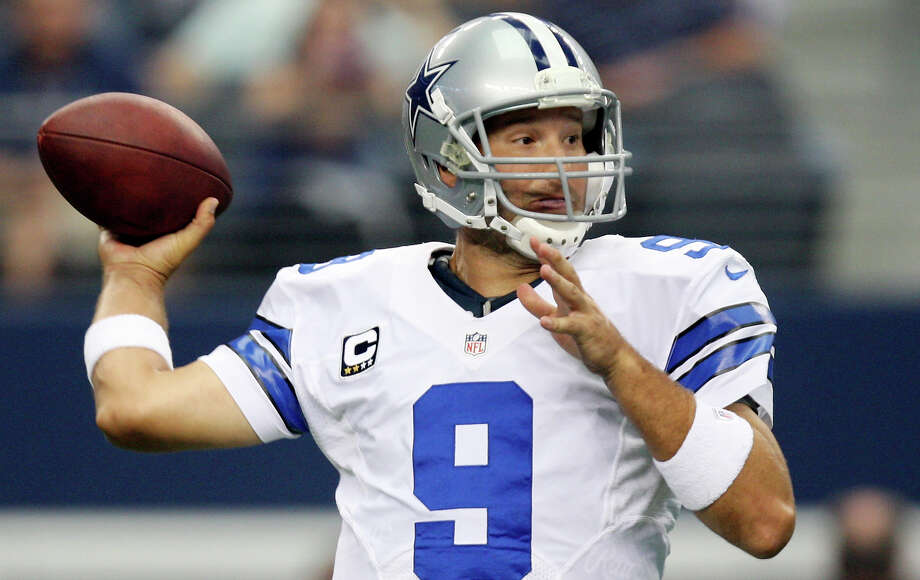Dallas Cowboys quarterback Tony Romo looks to pass the ball against the Tampa Bay Buccaneers, during the first half at Cowboys Stadium in Arlington, Texas, Sunday Sept. 23, 2012. Will Romo get an extension? Photo: Jerry Lara, San Antonio Express-News / © 2012 San Antonio Express-News