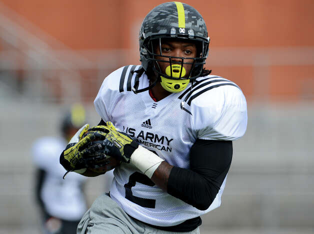 All-American Bowl running back Derrick Henry (above) rushed for 12,024 yards to break a 59-year mark by Ken Hall. Photo: John Albright,  For The Express-News / San Antonio Express-News