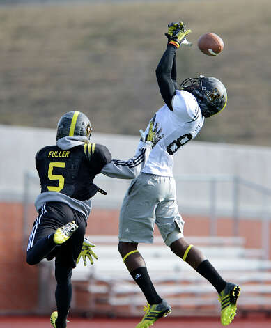 U.S. Army All-American Bowl East Team WR Tony Stevens (80) from Evans High School in Orlando, FL can't come down with a pass while U.S. Army All-American Bowl East Team DB Kendall Fuller (5) from Our Lady of Good Counsel High School in Baltimore, MD defends during a U.S. Army All-American Bowl East Team practice at Heroes Stadium, Tuesday, January 1, 2013. Photo: John Albright,  For The Express-News / San Antonio Express-News