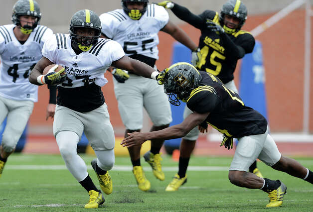 U.S. Army All-American Bowl East Team RB Derrick Green (27) from Hermitage High School in Richmond, VA stiff arms U.S. Army All-American Bowl East Team DB Dymonte Thomas (14) from Marlington High School in Alliance, OH during a U.S. Army All-American Bowl East Team practice at Heroes Stadium, Tuesday, January 1, 2013. Photo: John Albright,  For The Express-News / San Antonio Express-News
