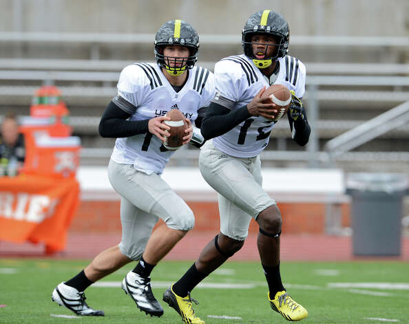 All-American Bowl East QBs Ryan Burns (left) from Stone Bridge High in Leesburg, Va., and Johnathon McCrary from Cedar Grove High in Stone Mountain, Ga., work out Tuesday. Photo: John Albright,  For The Express-News / San Antonio Express-News