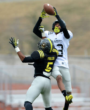 U.S. Army All-American Bowl East Team WR Tyler Boyd (23) from Clairton High School in Clairton, PA catches a pass over U.S. Army All-American Bowl East Team DB Kendall Fuller (5) from Our Lady of Good Counsel High School in Baltimore, MD during a U.S. Army All-American Bowl East Team practice at Heroes Stadium, Tuesday, January 1, 2013. Photo: John Albright,  For The Express-News / San Antonio Express-News