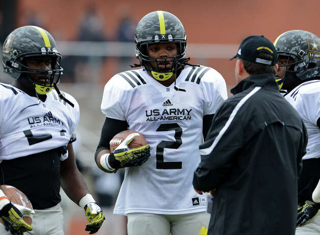 U.S. Army All-American Bowl East Team RB Derrick Henry (2) from Yulee High School in Yulee, FL stands with the other running backs and listens to a coach during a U.S. Army All-American Bowl East Team practice at Heroes Stadium, Tuesday, January 1, 2013. Photo: John Albright,  For The Express-News / San Antonio Express-News
