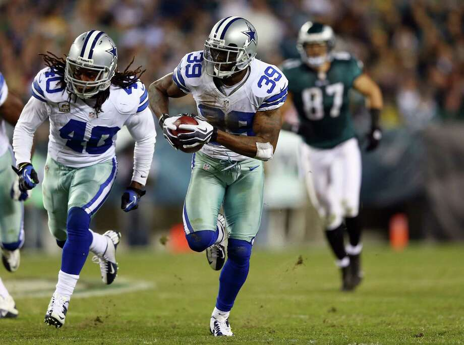 PASS DEFENSE — GRADE: C The secondary improved with Brandon Carr and Morris Claiborne at cornerback, but the Cowboys were one of only three teams with fewer than 10 interceptions. PHOTO: Carr (39) returns an interception for a touchdown as teammate Danny McCray (40) blocks in the fourth quarter against the Eagles on Nov. 11 in Philadelphia. Photo: Elsa, Getty Images / 2012 Getty Images