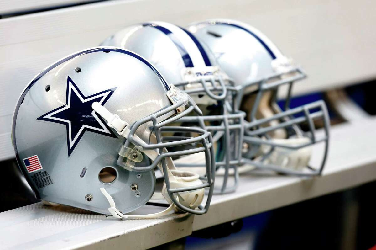 Express-News beat writer Tom Orsborn grades the Cowboys' 2012 season after they finished third in the NFC East and out of the playoffs at 8-8: PHOTO: Dallas Cowboys helmets sit on the bench during the first half against the New Orleans Saints in Dallas on Dec. 23.