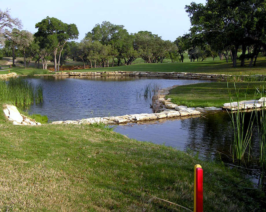 A beautiful, but challenging pond protects the approach on the par-4 No. 17 at Vaaler Creek Golf Club. Photo: San Antonio Express-News