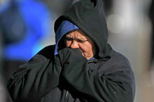 Sonia Vargas tries to keep warm as she waited for the light rail on Fannin near Pressler Wednesday, Dec. 26, 2012, in Houston. Photo: Johnny Hanson, Houston Chronicle / © 2012  Houston Chronicle