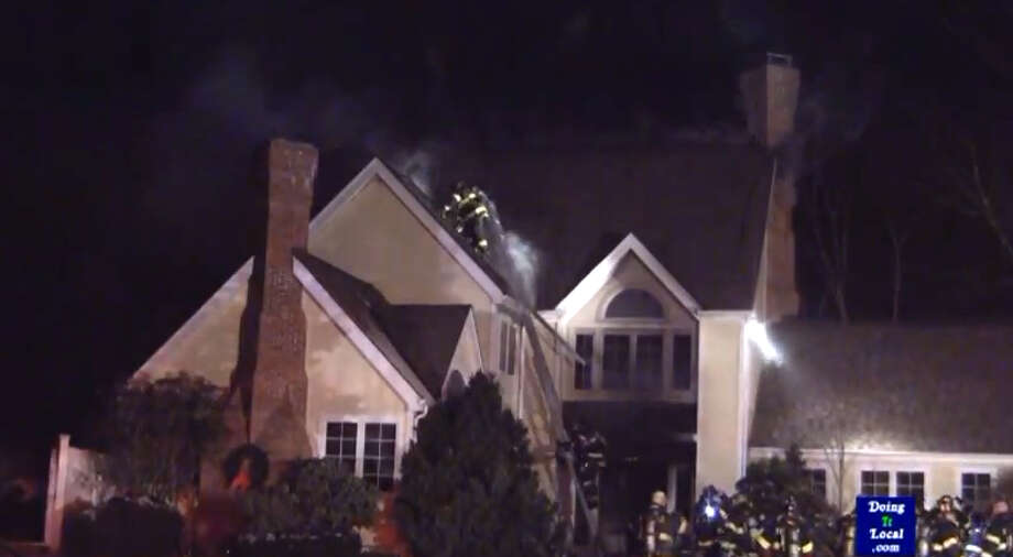 Firefighters respond to a house fire in Fairfield on Jan. 1, 2013. Photo: DoingItLocal.com