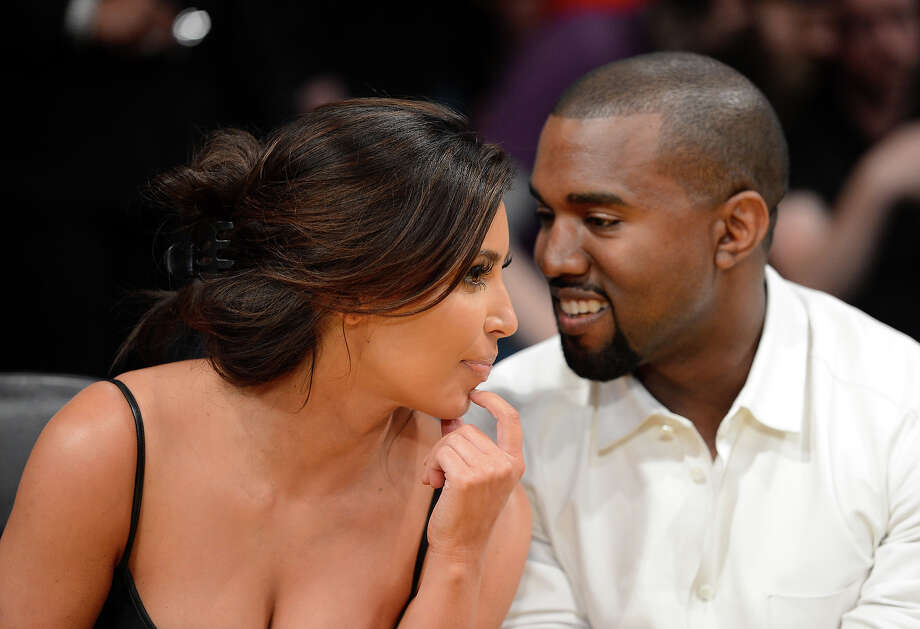 Kim Kardashian and rapper Kanye West talk from their courtside seats before the Los Angeles Lakers take on the Denver Nuggets in Game Seven of the Western Conference Quarterfinals in the 2012 NBA Playoffs on May 12, 2012 at Staples Center in Los Angeles, California. Photo: Harry How, Getty Images / 2012 Getty Images