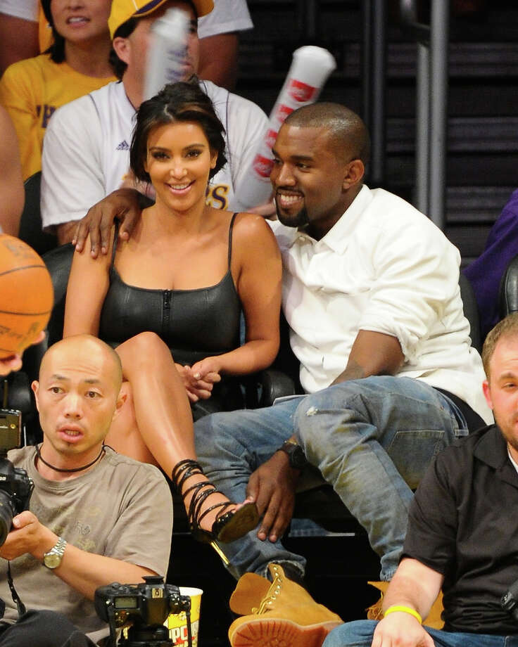 Kim Kardashian and Kanye West attend the Los Angeles Lakers and Denver Nuggets Game 7 of the Western Conference Quarterfinals in the 2012 NBA Playoffs on May 12, 2012 at Staples Center in Los Angeles, California. Photo: Noel Vasquez, Getty Images / 2012 Getty Images
