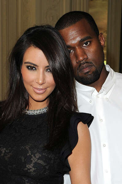 Kim Kardashian and Kanye West attend the Valentino Haute-Couture show as part of Paris Fashion Week