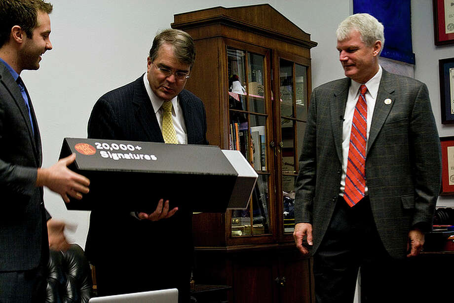 Jake Brewer delivers a petition (on a giant thumb drive) in support of legislation sponsored by Reps. John Culberson (R-TX) and Brian Baird (D-WA). Photo: Unknown