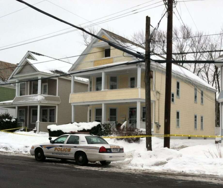 Schenectady police remained on the scene Wednesday morning of a Stanford Street home where 82-year-old former nun Mary Greco was found dead on New Year's Day. Police labeled Greco's death suspicious but are awaiting the results of an autopy before disclosing how she died. (SKIP DICKSTEIN / TIMES UNION)