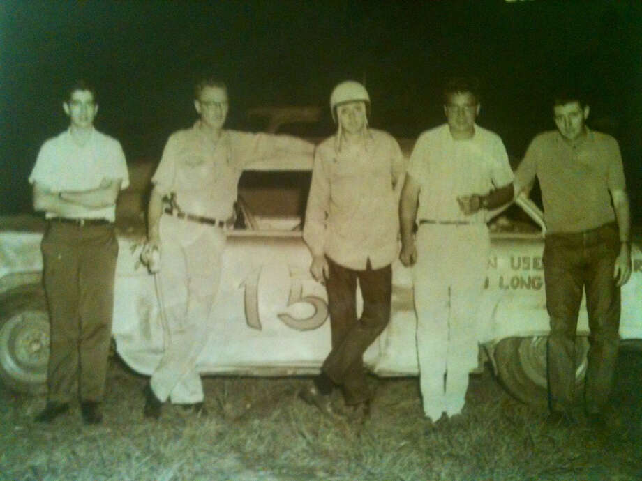 Rat Rod owner Don Waggonner, in the helmet, raced locally. He is pictured with, from left, Larry Horton; Mack, who volunteered to help in the pit; car owner David McWilliams; and Johnny Bennett. (F.L. 'Mac' MacKenzi photo)