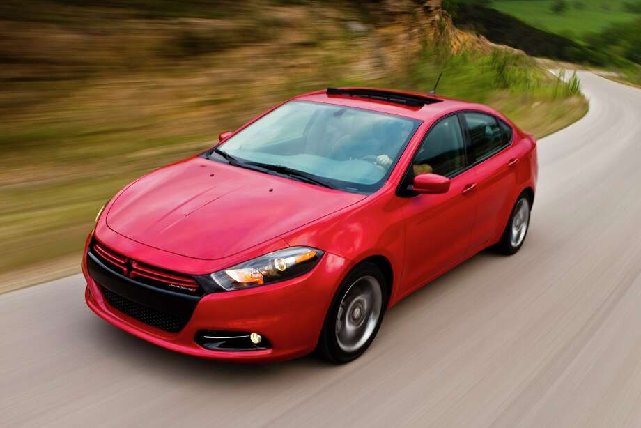 """2013 Dodge Dart: Dodge gives this sedan some power with a 160-horsepower turbocharged engine. Critics are drooling over this car. What KBB said: """"A hot new face in the compact sedan field, the Dodge Dart puts its own high-styled spin on 4-door practicality.""""Base Price: $20,090 See what Kelley Blue Book saidabout all the models. Photo: AP Photo/Scion)"""