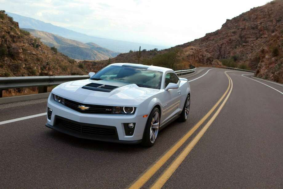"2013 Chevrolet Camaro: You might be surprised to hear that you can get a Camaro for under $25,000. The base model will still give you plenty of performance and style. What KBB said: ""Cool is exemplified by its exterior design, which not only pays homage to previous generations of the vaunted pony car, but also thrusts it in a futuristic direction.""Base Price: $24,245 Photo: Handout, Chevrolet / Chevrolet"