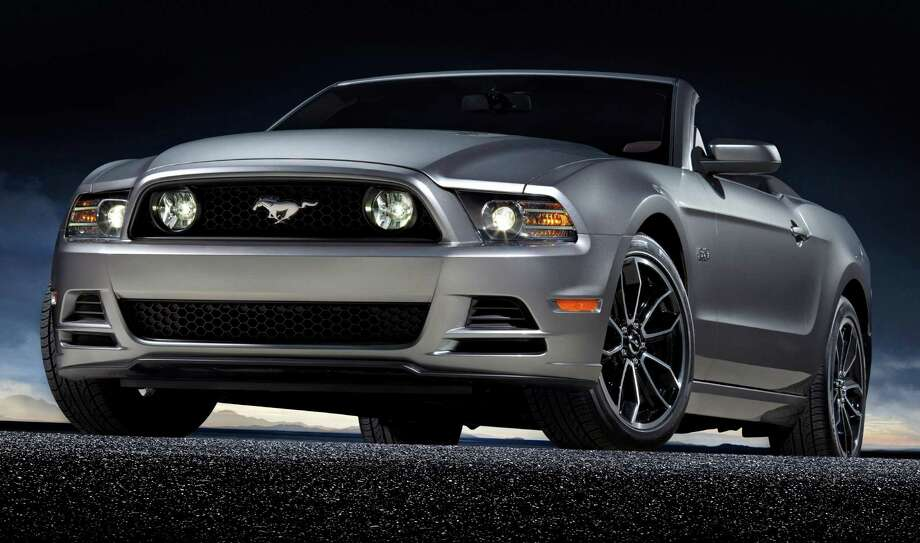 "2013 Ford Mustang: Ford's iconic car has been revamped for the upcoming year. The car packs power, a bit of fuel economy and same classic design. What KBB said: ""Bolder front and rear fascias add even more visual kick for 2013.""