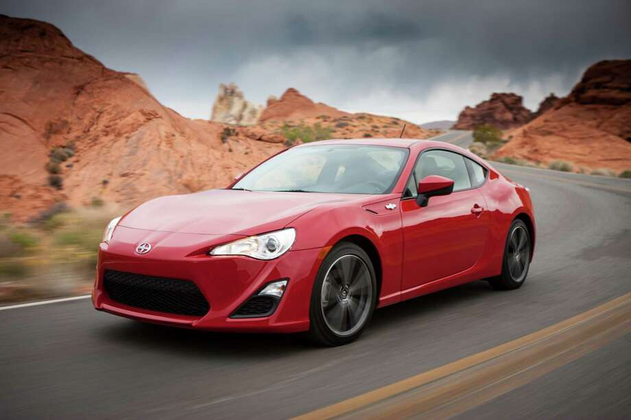 """2013 Scion FR-S: The economical sports car has gotten rave reviews, and Kelley Blue Book also heaped on the praise. What KBB said: """"We like that it has a high-revving engine, sleek looks and enough grip to hang in the corners with cars twice its price.""""Base Price: $24,955 Photo: AP Photo/Scion / Scion"""
