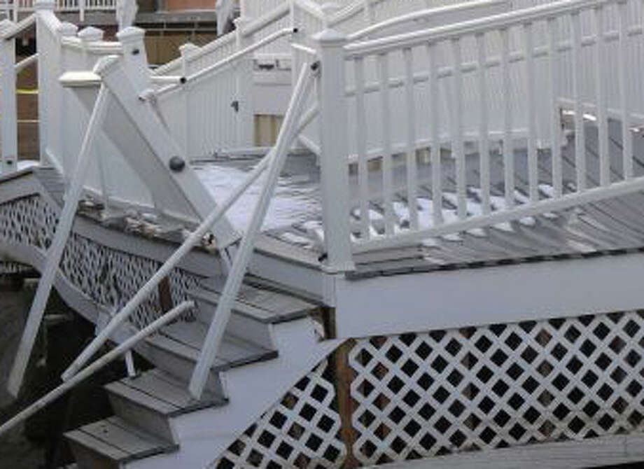 Repairs to public properties damaged in Fairfield by Superstorm Sandy -- including Penfield Pavilion, which suffered buckled floors and broken railings when the strom surge undermined the structure -- will cost more than $5 million, according to a report prepared for the Board of Selectmen. Photo: File Photo / Fairfield Citizen