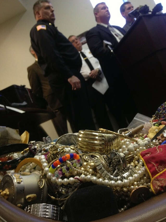 Police show some of the loot confiscated from 31 duffel bags on Wednesday, Jan. 2, 2013, in Hudson Falls, N.Y. (Cindy Schultz/Times Union)