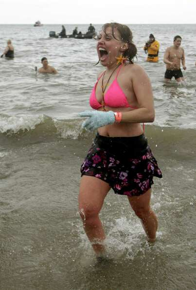 Anna Romanovich takes the plunge in 30-degree temperatures during the 110th annual Coney Island Pola