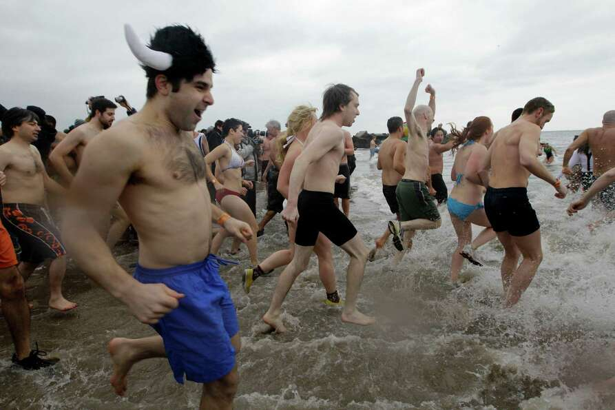 Swimmers head for the water in 30-degree temperatures during the 110th annual Coney Island Polar Bea