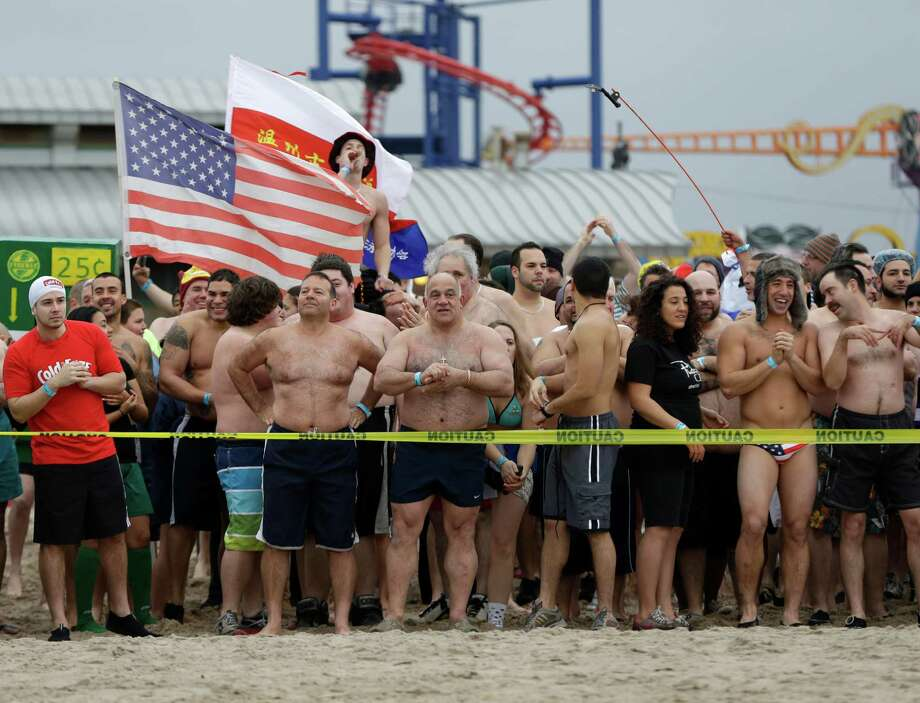 Swimmers in the first wave to enter the water wait for the start of the 110th annual Coney Island Polar Bear Club ocean swim at Coney Island in New York, Tuesday, Jan. 1, 2013. Photo: Kathy Willens, AP / AP