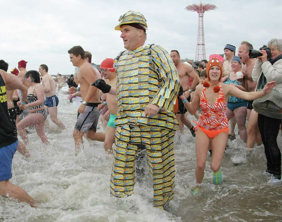 NEW YORK, NY - JANUARY 1:  A man wearing a costume made of Metrocards takes part in the Coney Island Polar Bear Club's New Year's Day swim on January 1, 2013 in the Coney Island neighborhood of the Brooklyn borough of New York City. The annual event attracts hundreds who brave the icy Atlantic waters and temperatures in the upper 30's as a way to celebrate the first day of the new year. Photo: Monika Graff, Getty Images / 2013 Getty Images