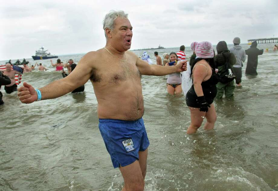 NEW YORK, NY - JANUARY 1: A man reacts as he feels the elements during the Coney Island Polar Bear Club's New Year's Day swim on January 1, 2013 in the Coney Island neighborhood of the Brooklyn borough of New York City. The annual event attracts hundreds who brave the icy Atlantic waters and temperatures in the upper 30's as a way to celebrate the first day of the new year. Photo: Monika Graff, Getty Images / 2013 Getty Images