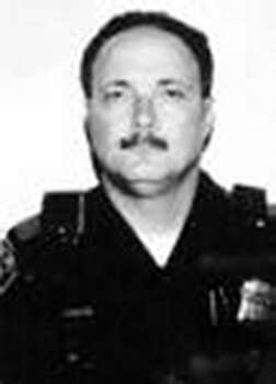 Rondall Sisco, Sept. 22, 1992 Officer Sisco, a Traffic Division motorcycle officer, was en route to the Central Substation when an automobile exiting the freeway struck his motorcycle. Sisco, 45, died as a result of severe head injuries. He has been on the force for 21 years. Photo: SAPD