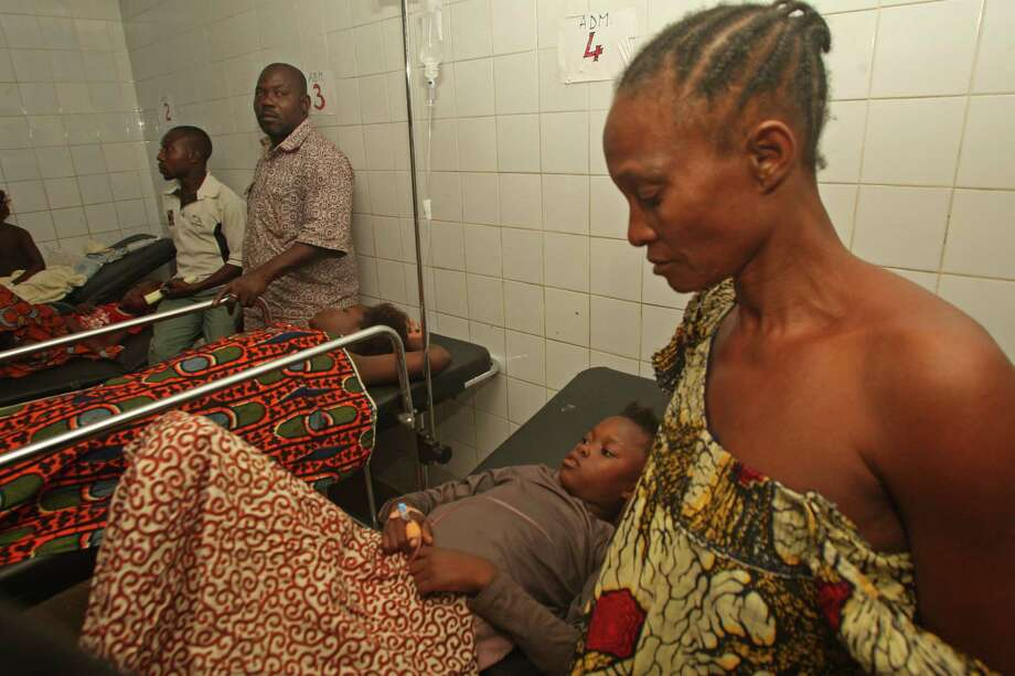 People injured in a stampede lie on hospital beds in Abidjan, Ivory Coast, Tuesday, Jan 1 2013. At least 61 people were killed early Tuesday in a stampede following a New Year's fireworks display in Abidjan, Ivory Coast's commercial center, said officials. The death toll is expected to rise, according to rescue workers. Photo: Emanuel Ekra, AP / AP